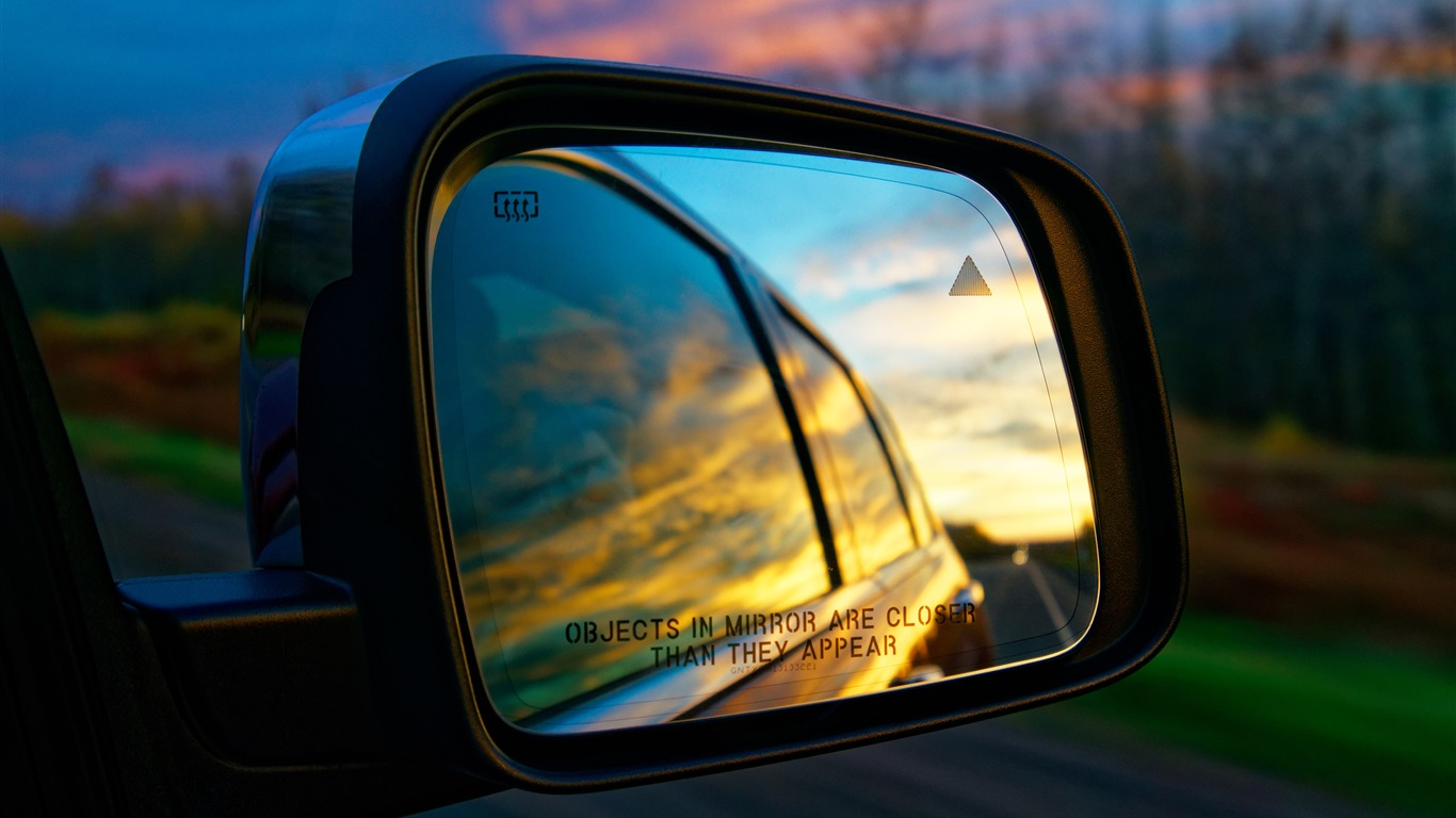 Car_rear_view_mirror_sunset_landscape_4K_Ultra_HD