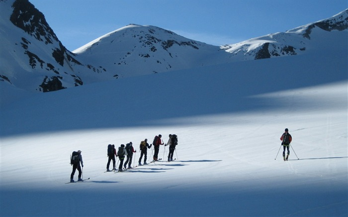 Skiers Walking in snow - Alps Ski Vacation Views:7924