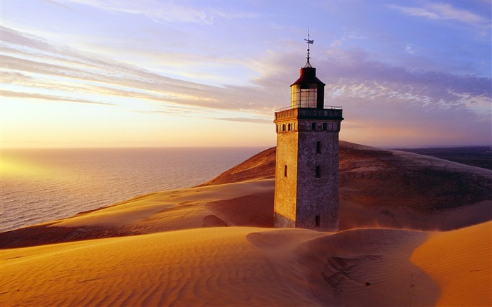 about to be engulfed in Denmark Rubjerg Knude quicksand lighthouse wallpaper Views:9966