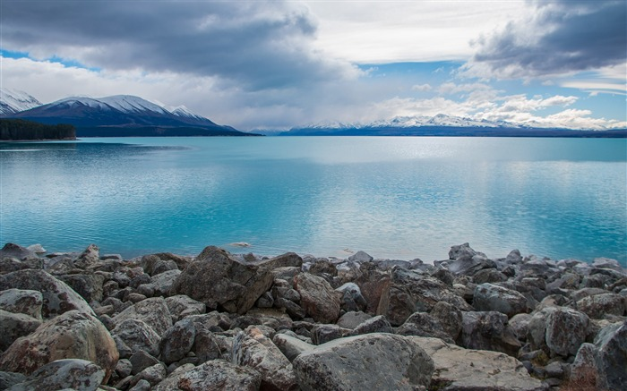 Lake Pukaki stones clouds mountains Photo HD Wallpaper Views:269