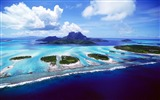 Title:Photo Blue island with blue sky and clouds Aerial Ocean Photo Views:10509