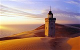 Title:about to be engulfed in Denmark Rubjerg Knude quicksand lighthouse wallpaper Views:8926